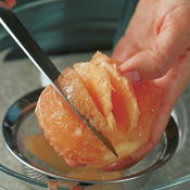 Remove the segments of citrus by cutting out the wedges that lie between the membranes.