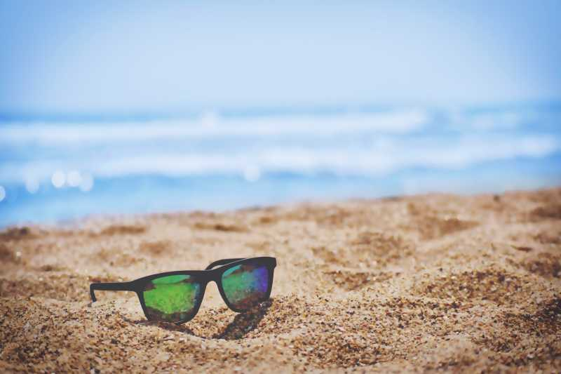 This is an image of a pair of sunglasses on the beach..jpg