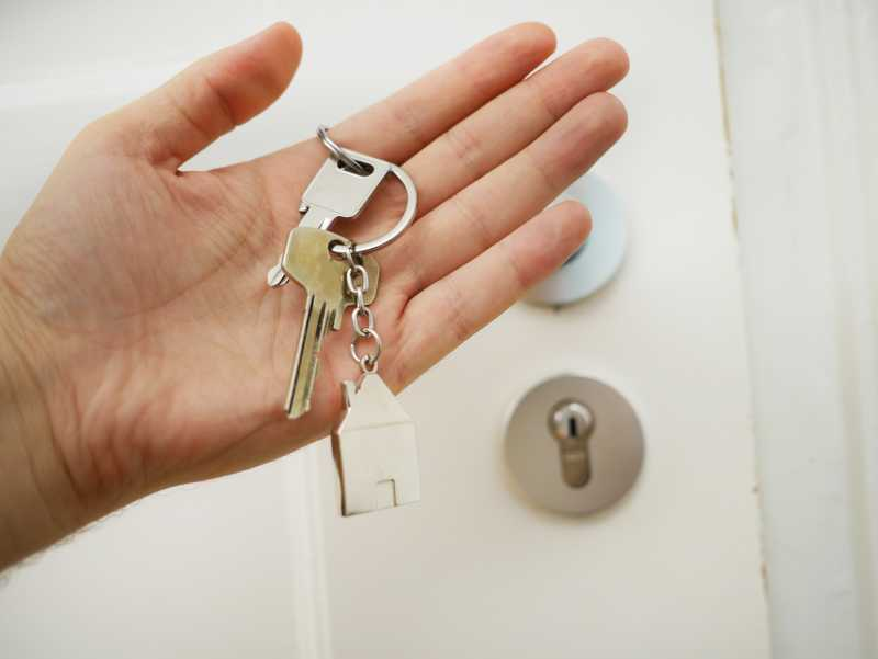 This is an image of a person holding house keys..jpg