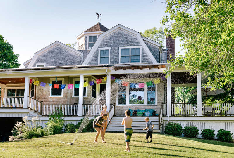This is an image of children playing in front of a vacation home.