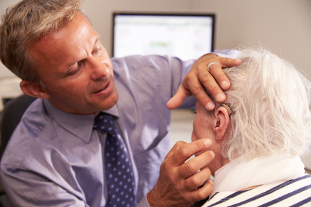 doctor-fitting-hearing-aid