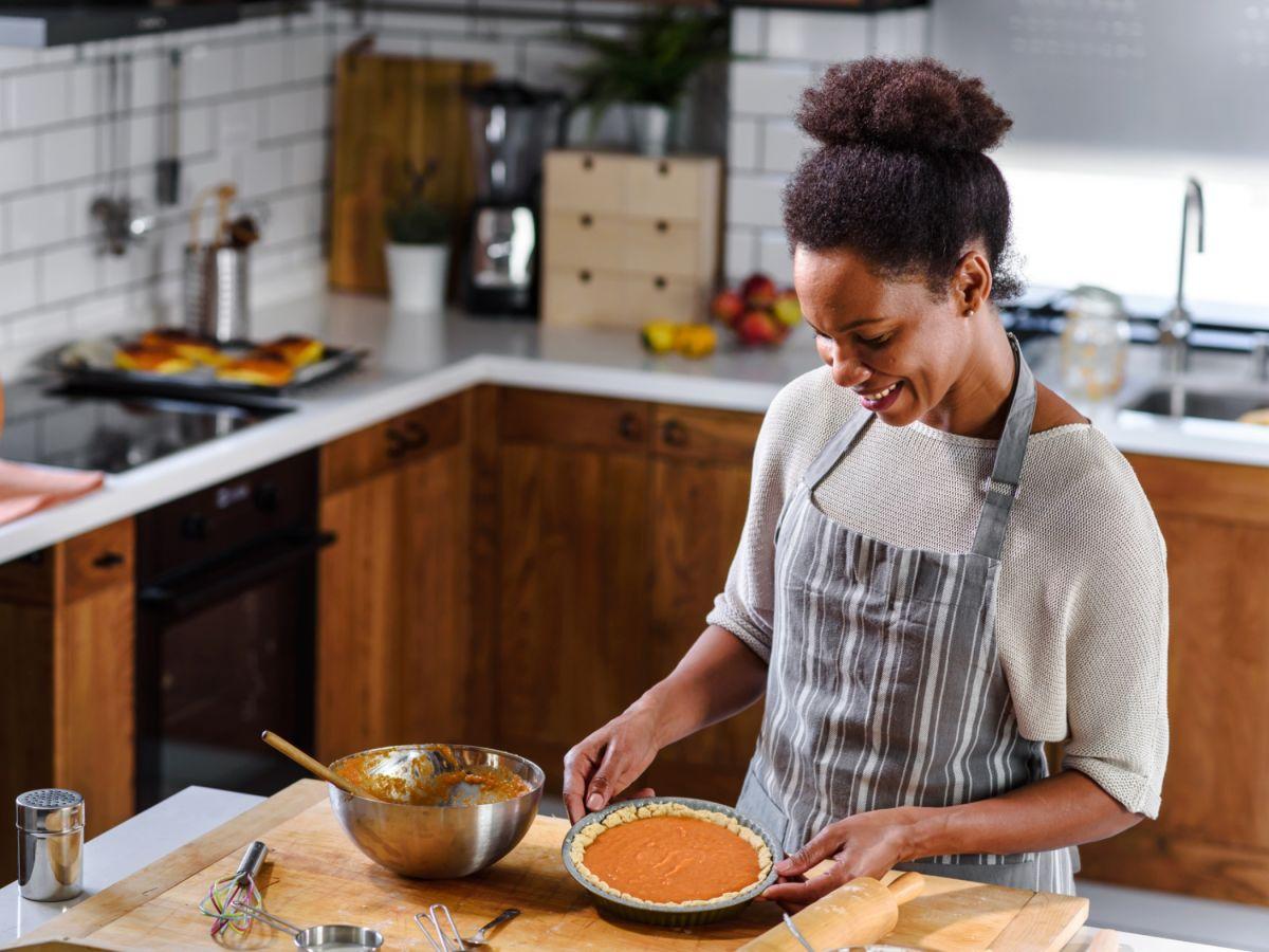 Woman baking pumpkin pie