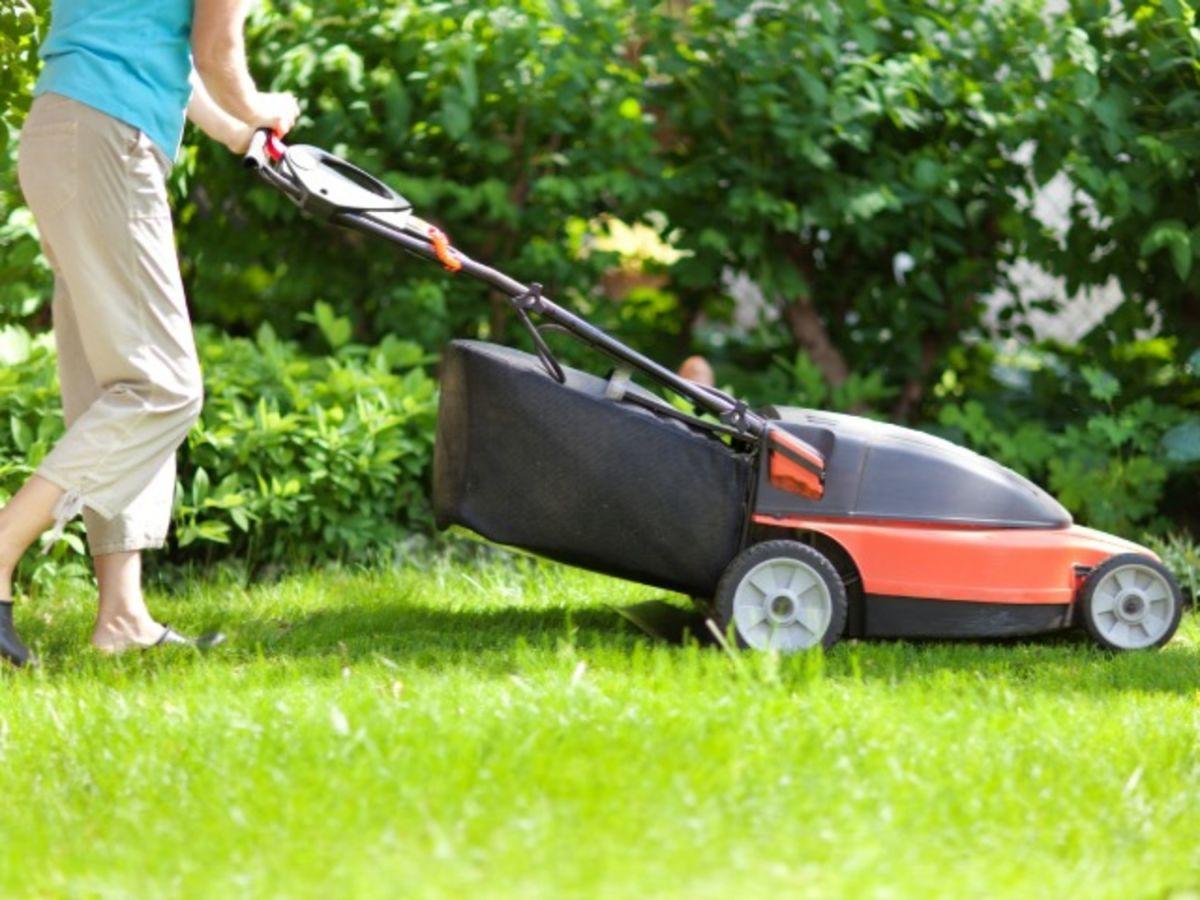 Woman using cordless mower