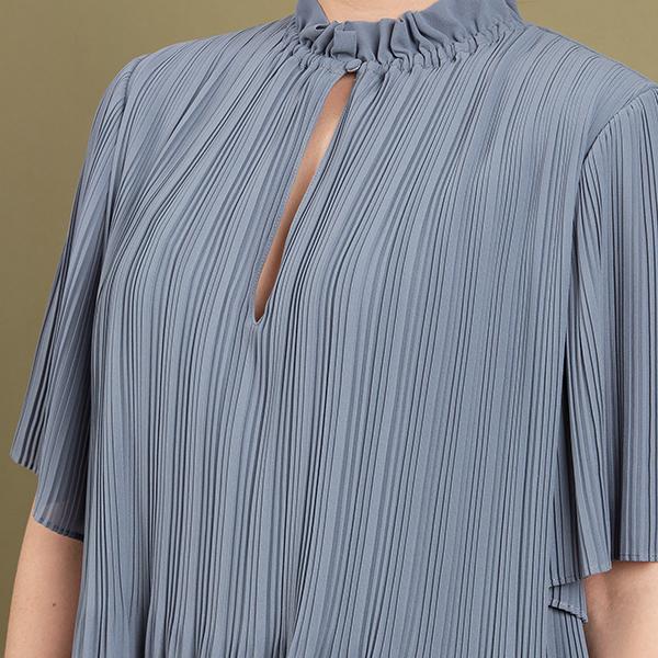 Tekstiilin riippukuivaus märkänä varjossa