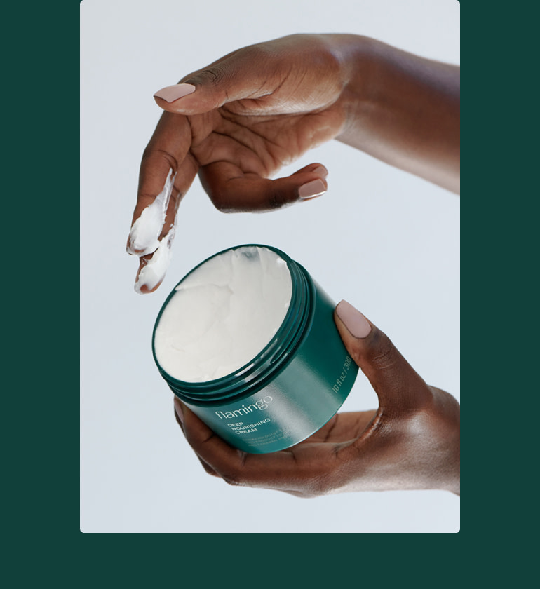 Woman applying deep nourishing cream