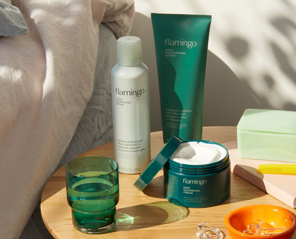 Light hydrating spray, daily moisturizer, and deep nourishing cream on bedside table.