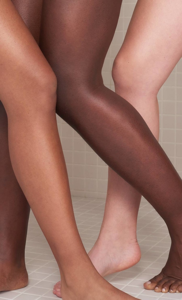 Three  women with moisturized Legs, knees to toes.