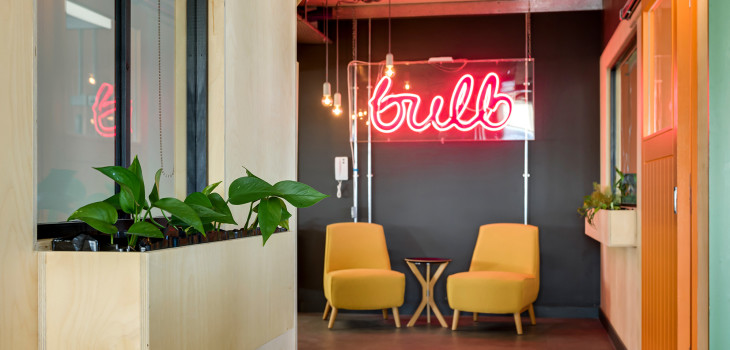 Bulb neon sign in the Brighton office space