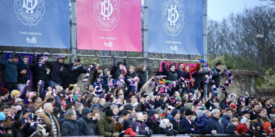 Dulwich Hamlet fans celebrating in front of Bulb banners