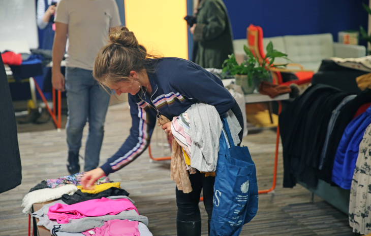 Team Bulb member shopping for clothes in our Bulb Clothes Swap