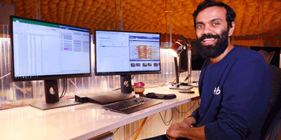 Amit at his desk