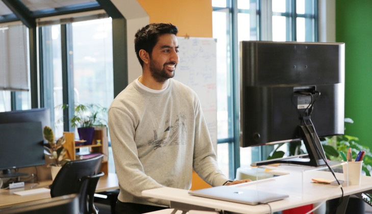 Ashwin, a data scientist, working at his desk