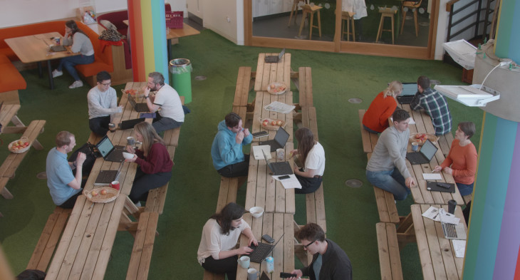 innocent team members eating lunch at picnic benches