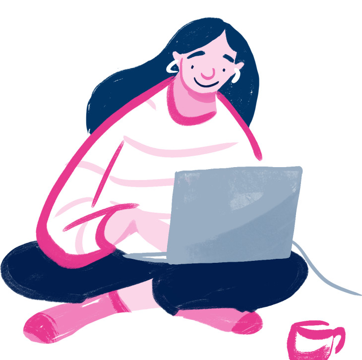A woman sitting down, cross-legged, on her laptop.