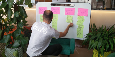 A member of Team Bulb consulting the Open Roadmap