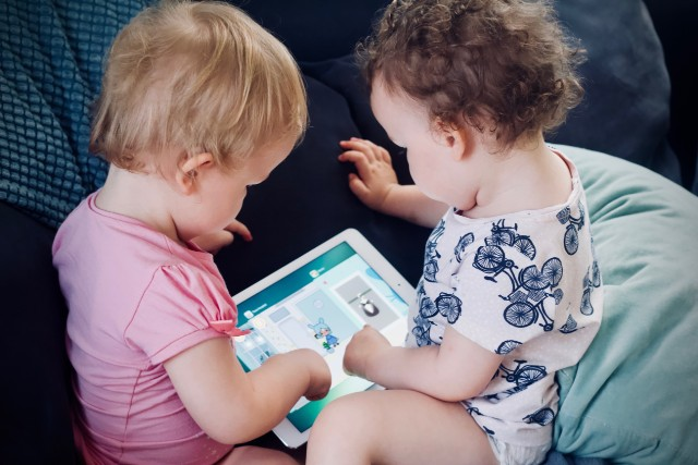 Toddlers looking at tablet