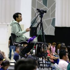 Camera operator filming the conference at Christ Fellowship Church International (CCFI)