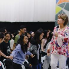 Cristina Sosso standing before the crowd at Christ Fellowship Church International (CCFI) in General Santos City.