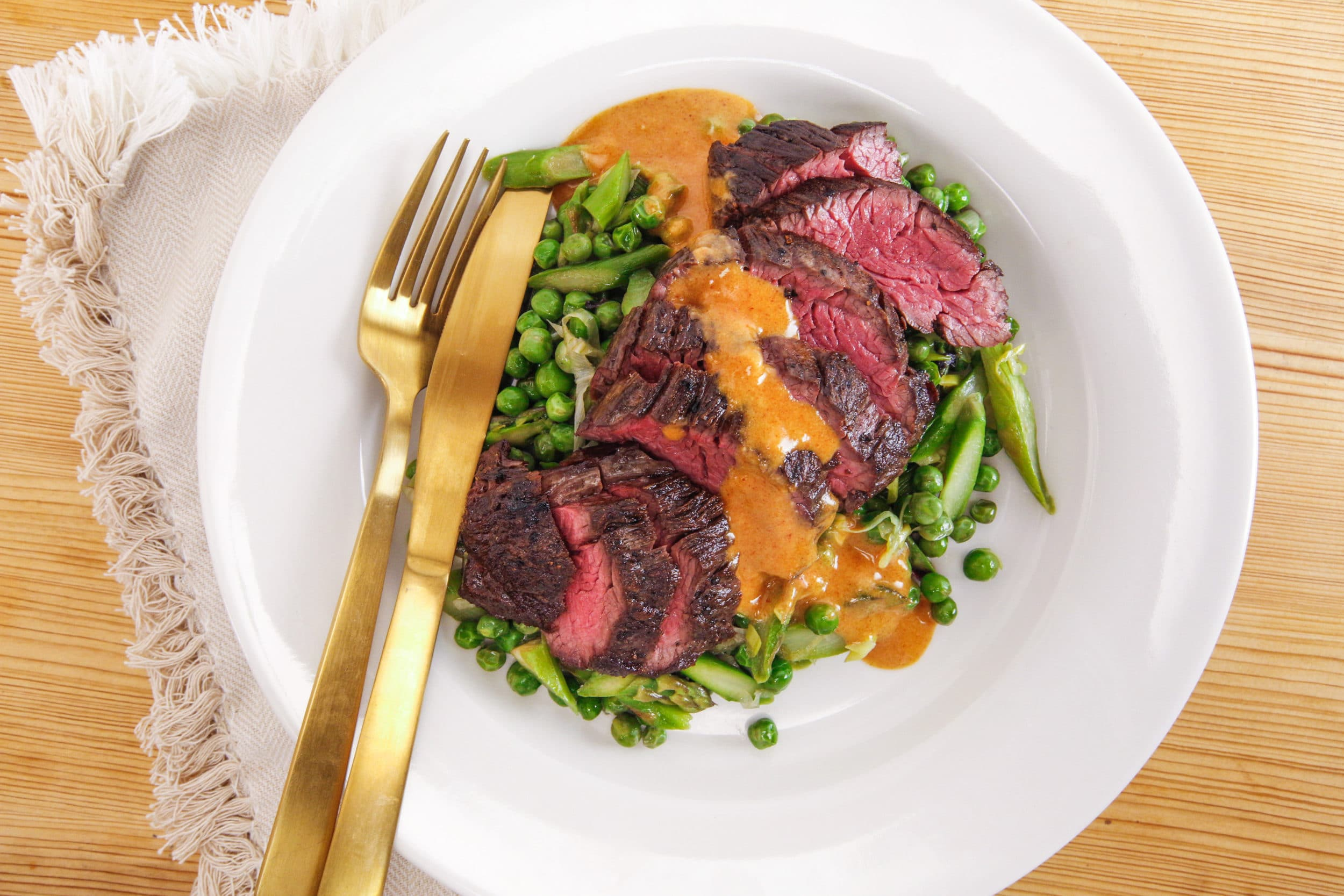 Rachael's Sliced Hanger Steak with Smoky Mustard Dressing and Spring Vegetables with Shallots and Greens