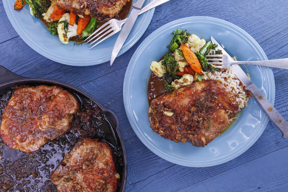 Orange-Glazed Pork Chops, Roasted Vegetable Medley and Almond Rice Pilaf