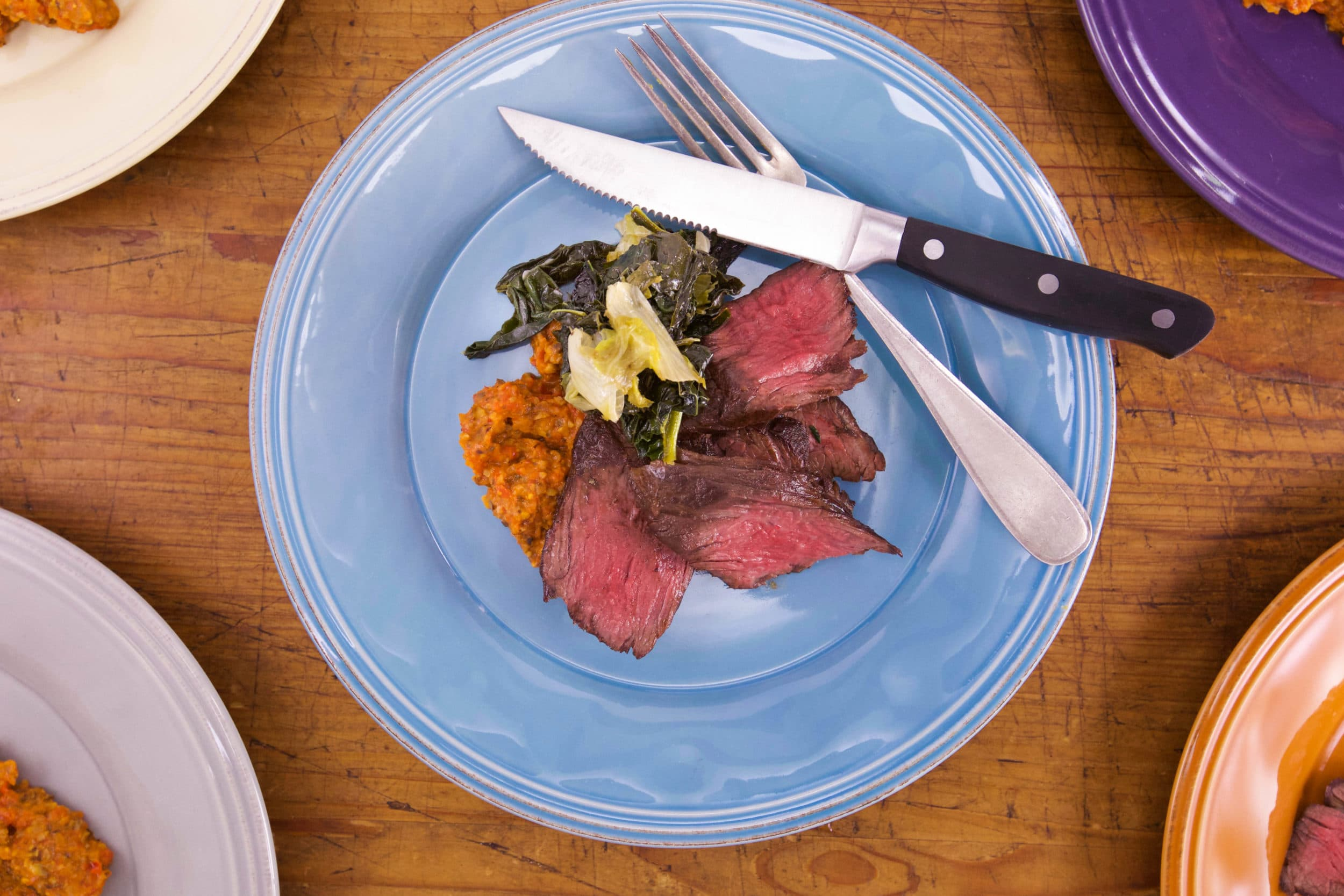Steak with Three-Pepper Bomba and Braised Greens