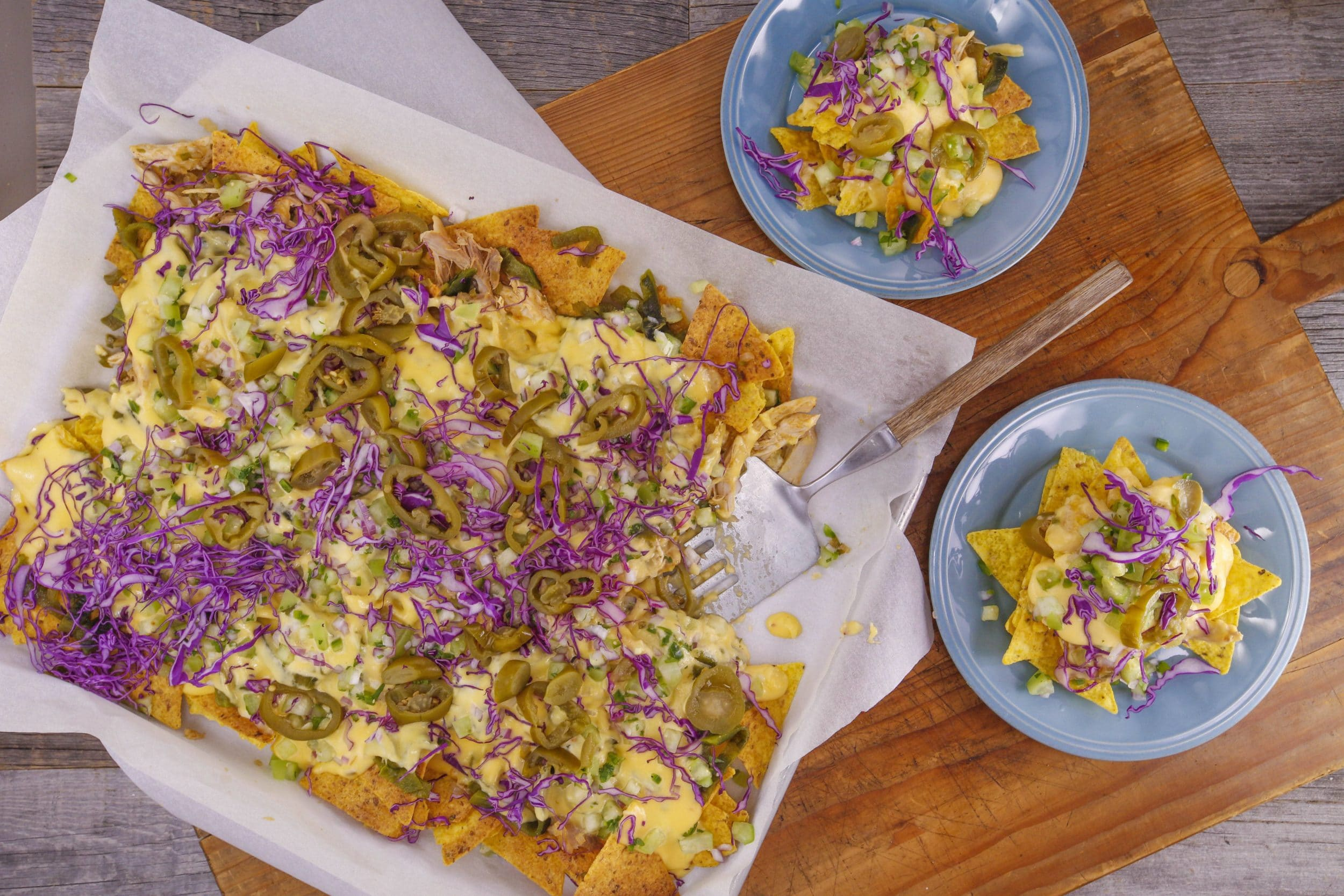 Poblano and Chicken Nachos with Queso and Raw Salsa Verde