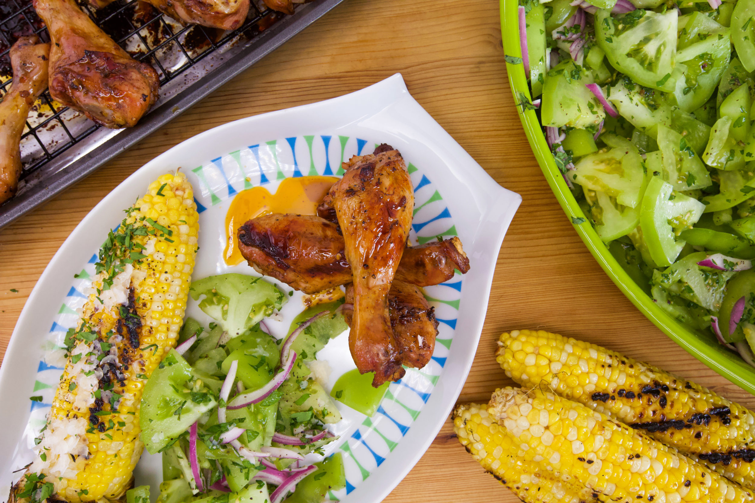Rachael's Balsamic-Marinated Chicken Legs, Green Tomato Salad and Corn with Garlic Butter