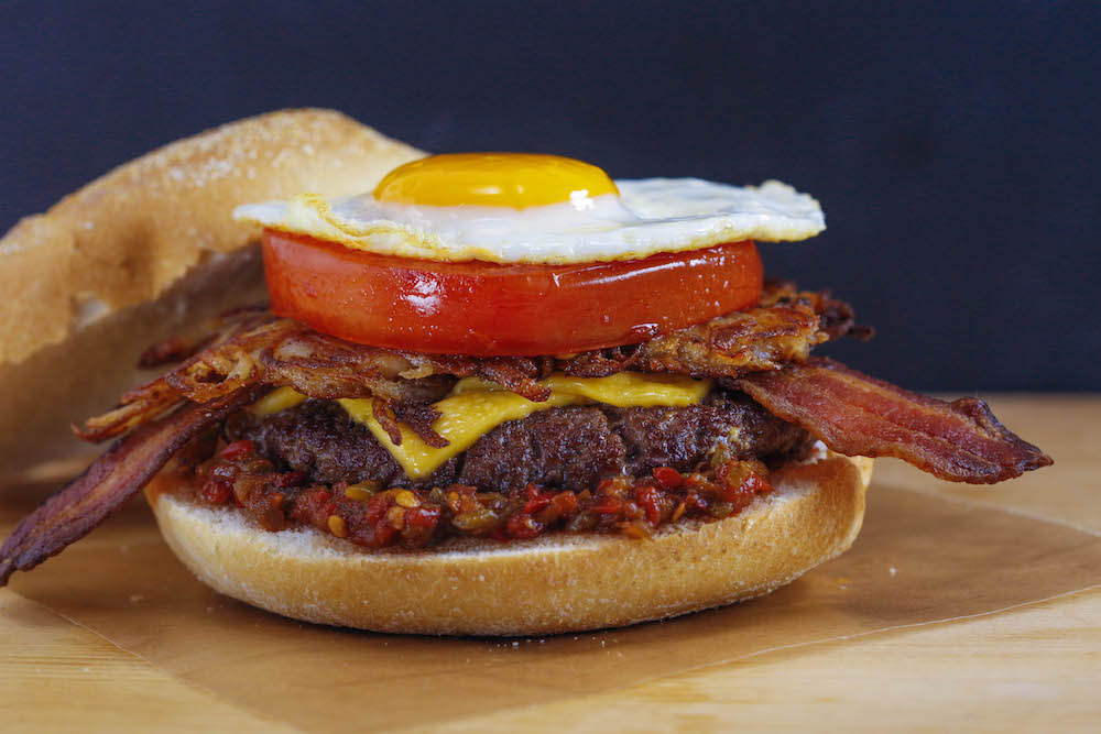 Bacon, Egg and Cheeseburger on a Roll with Spicy Mustard Hash Browns