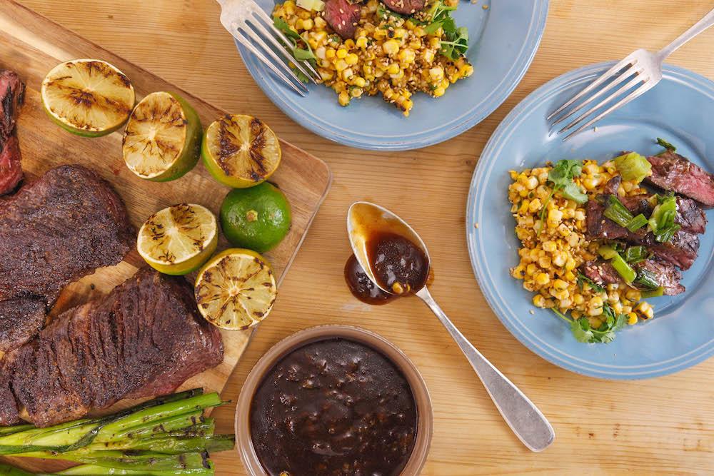 Hoisin-Ginger Steak with Grilled Onions and Sesame Sriracha Corn