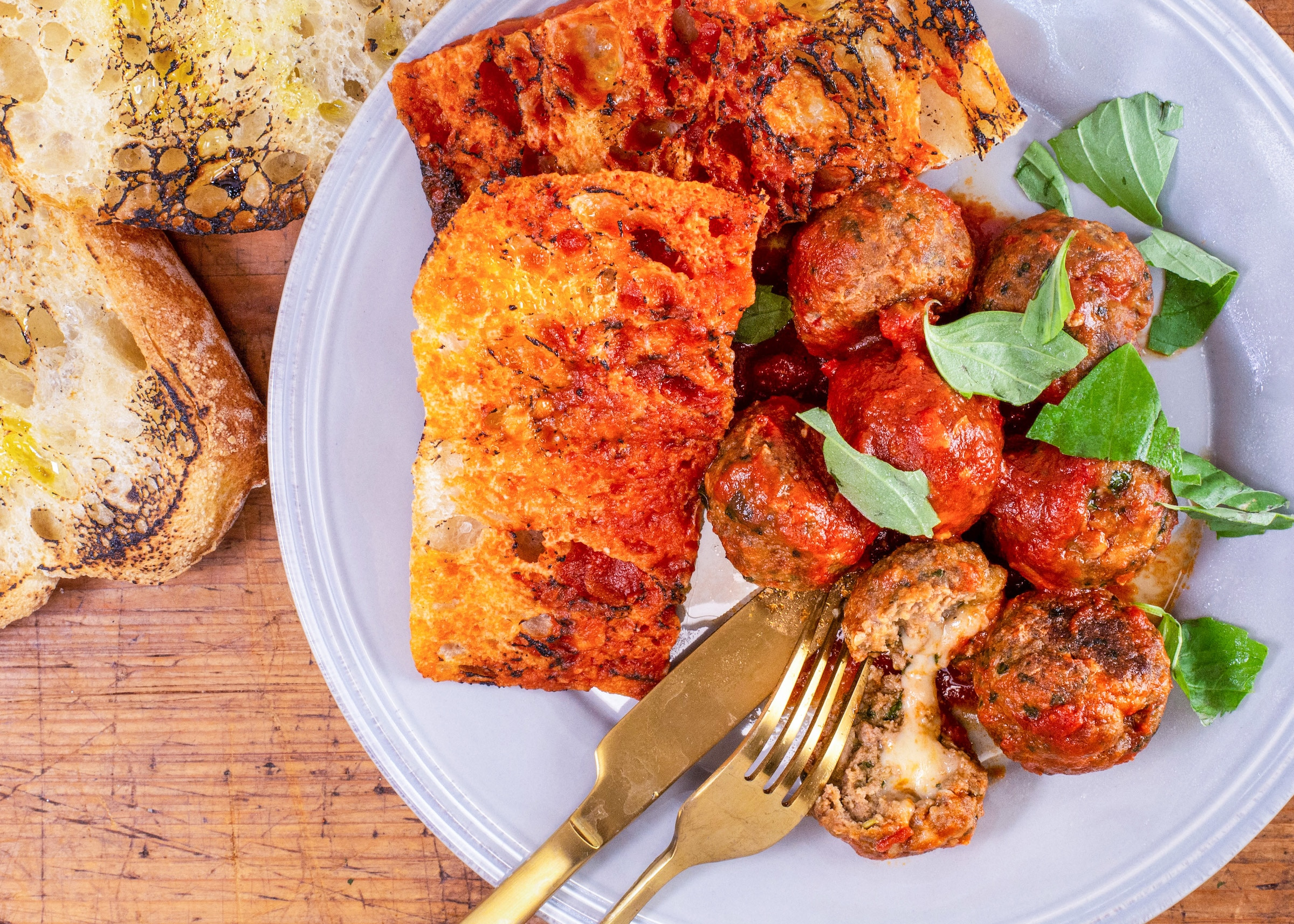 Rachael's Provolone-Stuffed Meatballs With Kale