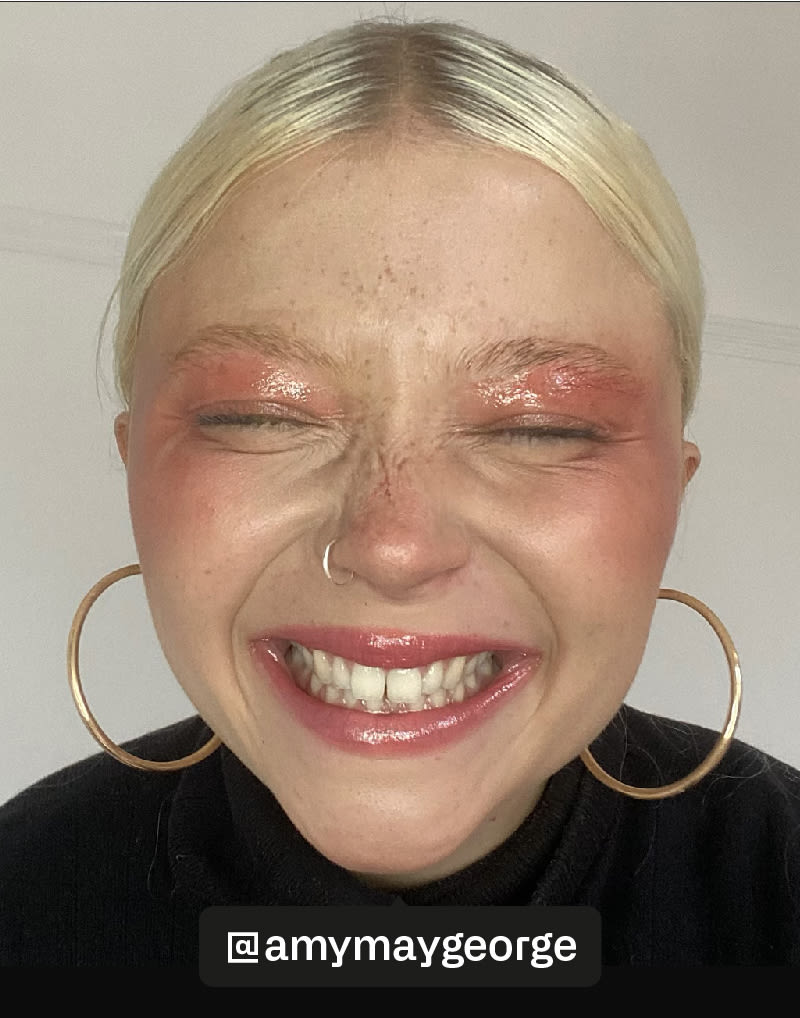 blonde girl smiling with pink makeup