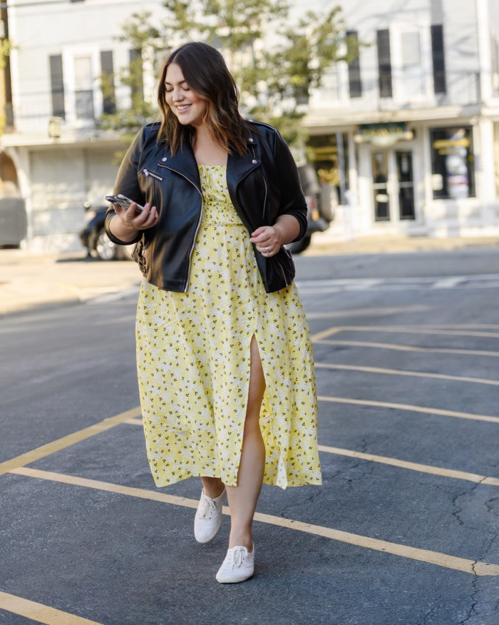 black leather jacket and a yellow midi dress
