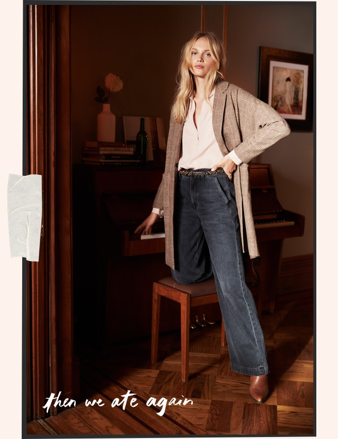 model wearing wide leg jeans with an oversized blazer.