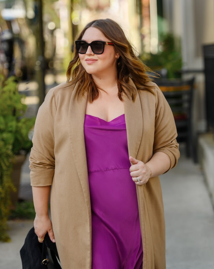 camel coat paired with a slip dress