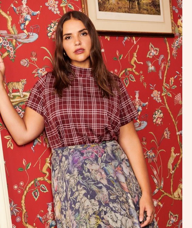 Pair a plaid top with a floral print flowy skirt!