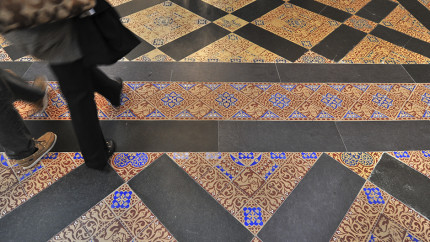 Encaustic tiles designed by Augustus Pugin are seen throughout the Palace of Westminster.