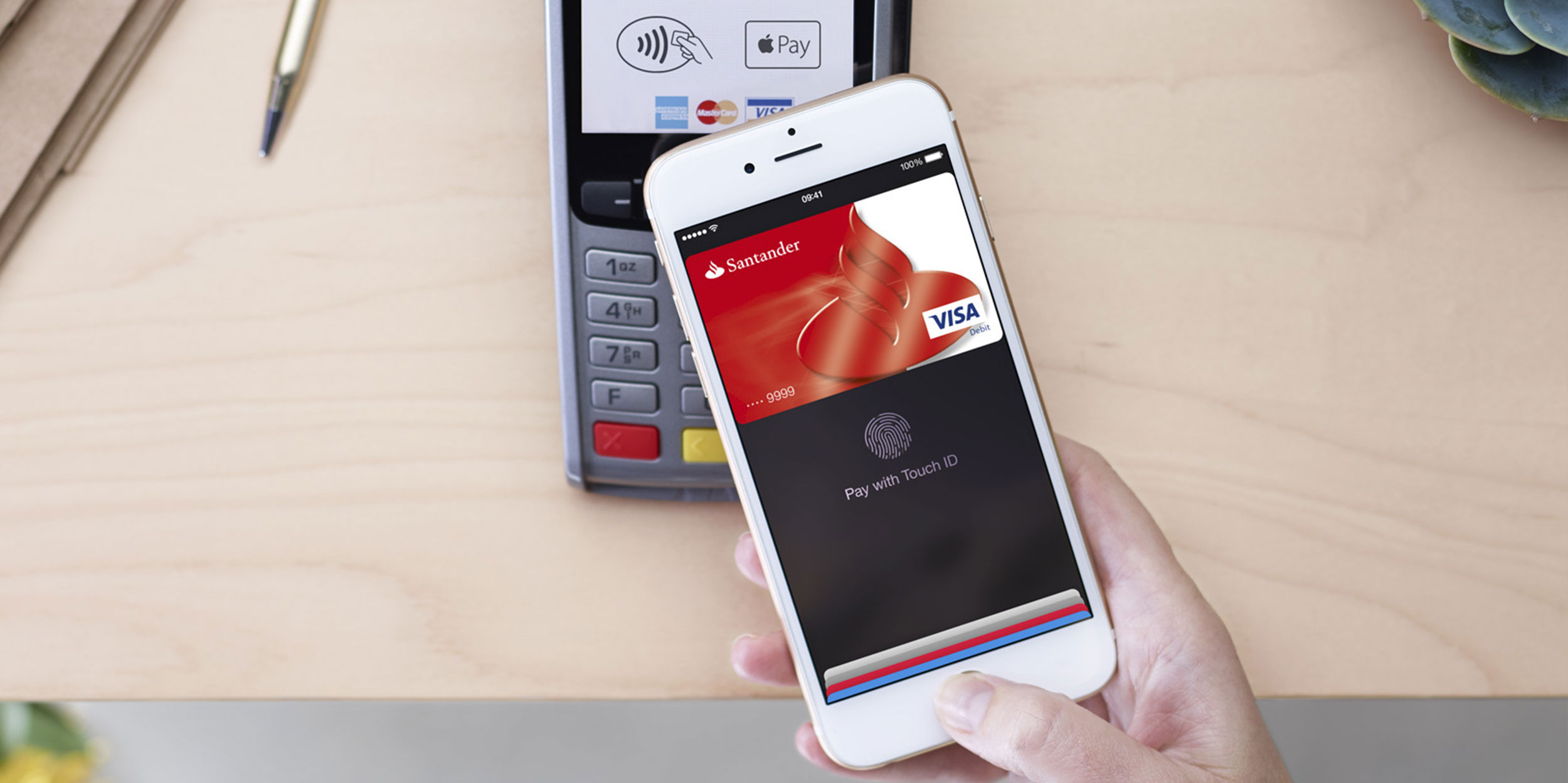An iPhone using Apple Pay on a credit card reader.