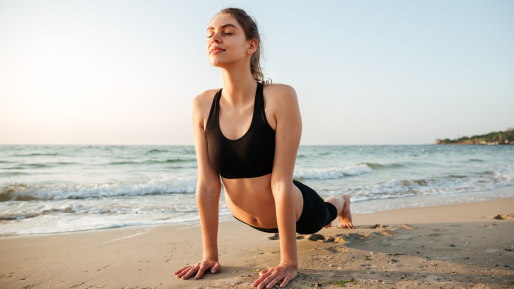 A girl doing yoga on the beach