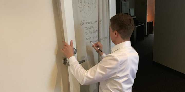 Dylan solving a whiteboard problem