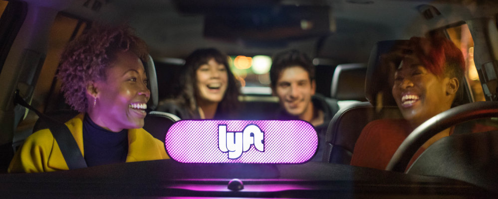 Friends riding home in a Lyft Lux