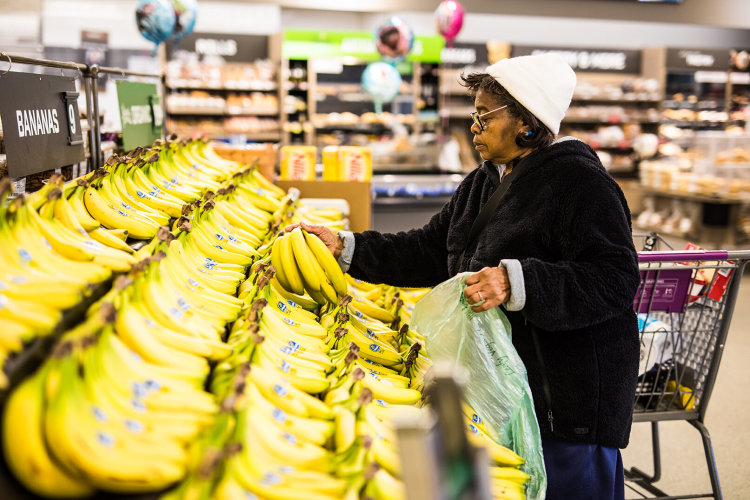 Grocery Access Blog post > Florestine buying bananas