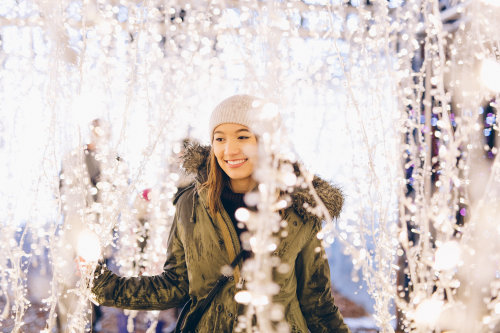 Enchant-Christmas-Hanging-Lights-Young-Woman