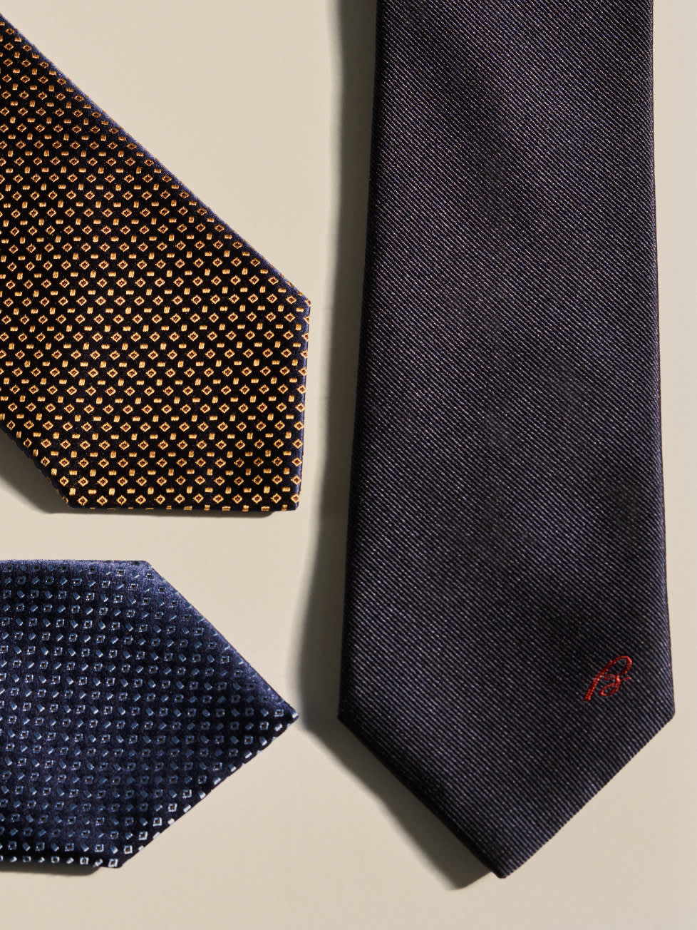 Three Brioni made-to-order ties in different fabrics and patterns