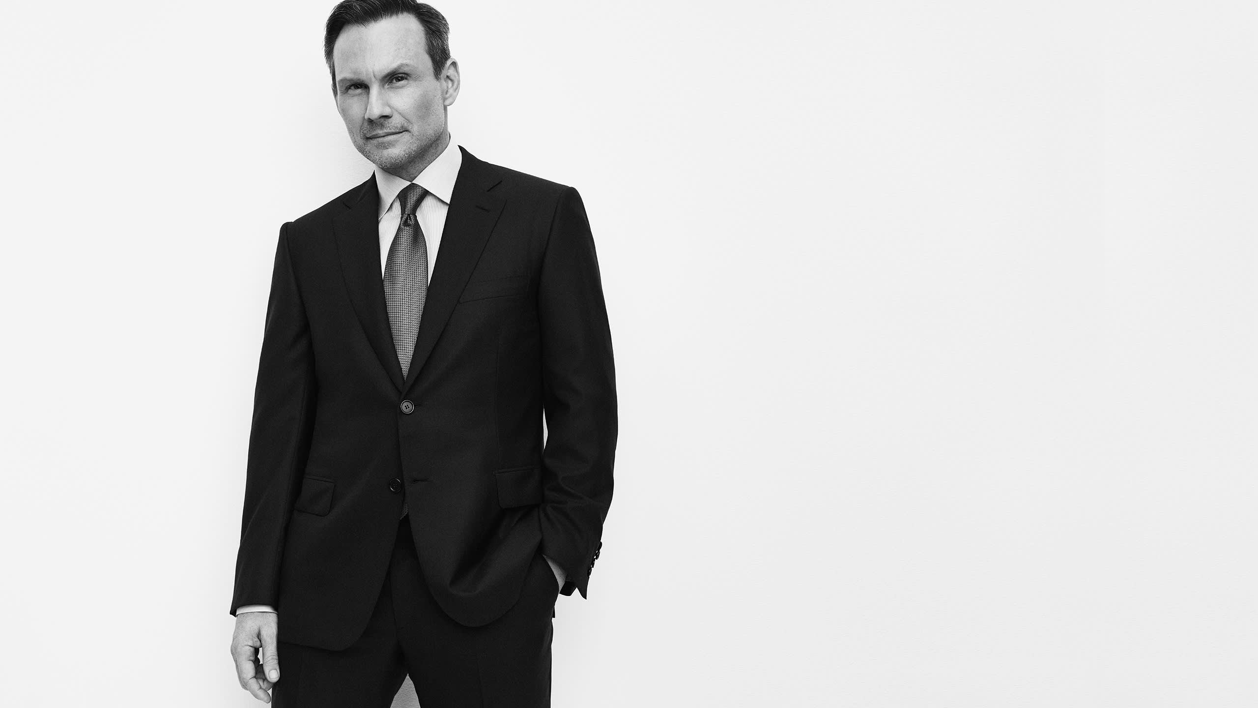 Christian Slater wearing a suit and shirt from the Brioni Essential collection