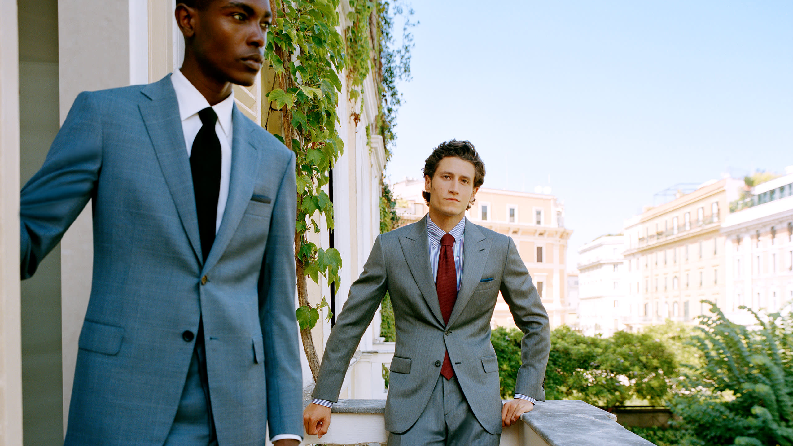 Male model wearing a Brioni double-breasted suit in grey wool