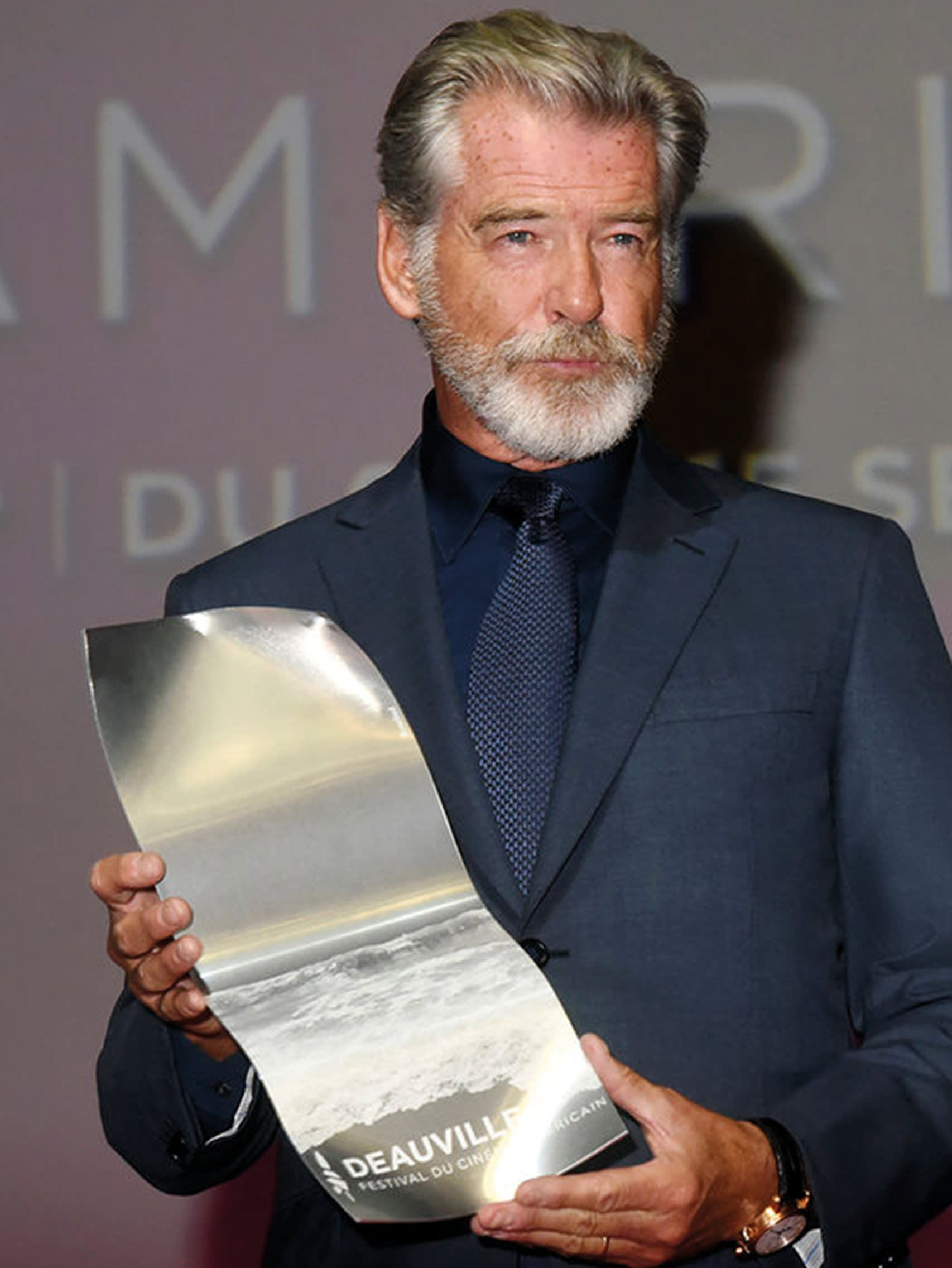 Pierce Brosnan wearing a Brioni bespoke blue suit