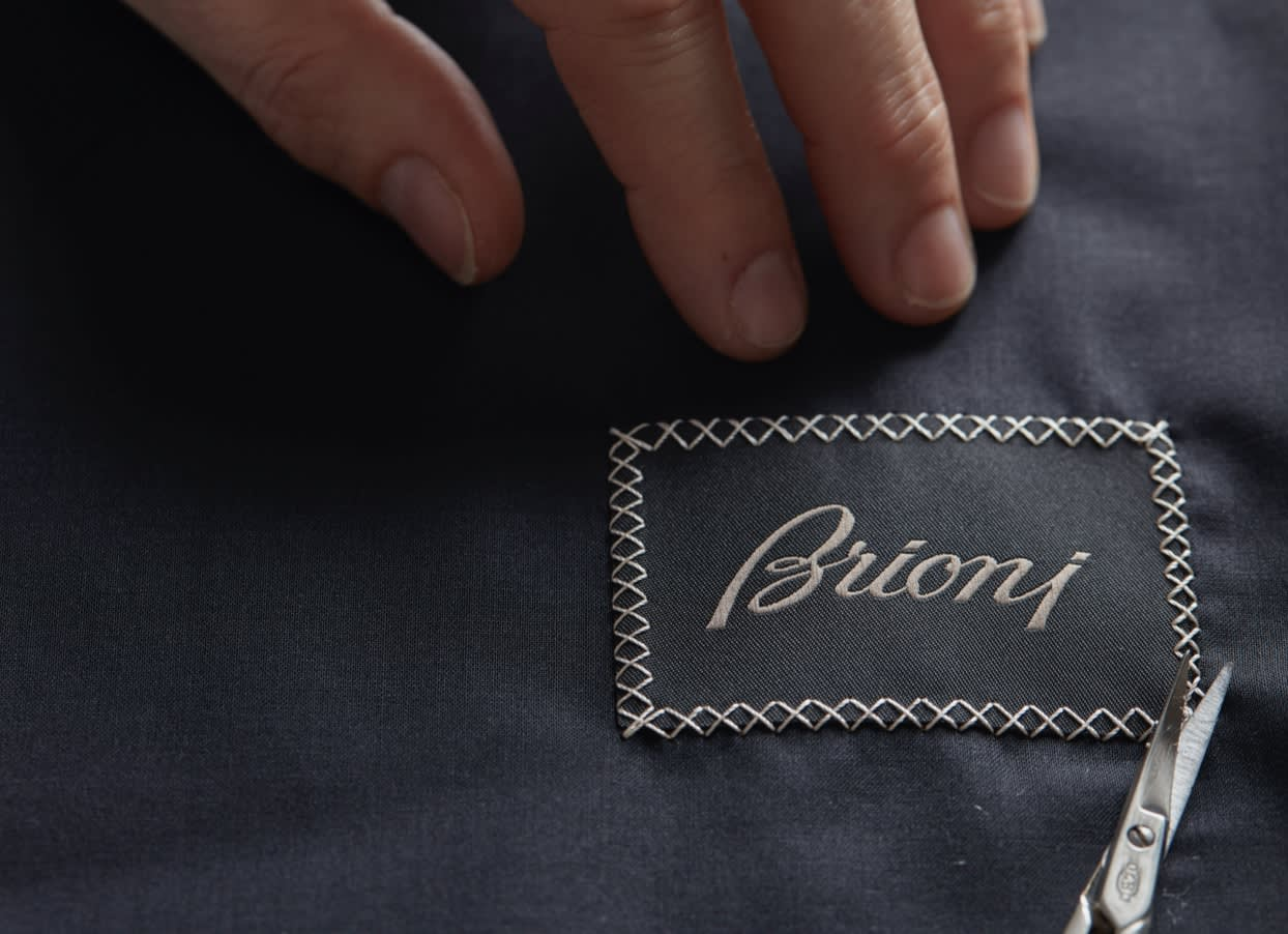 The iconic Brioni label is hand stitched on a garment