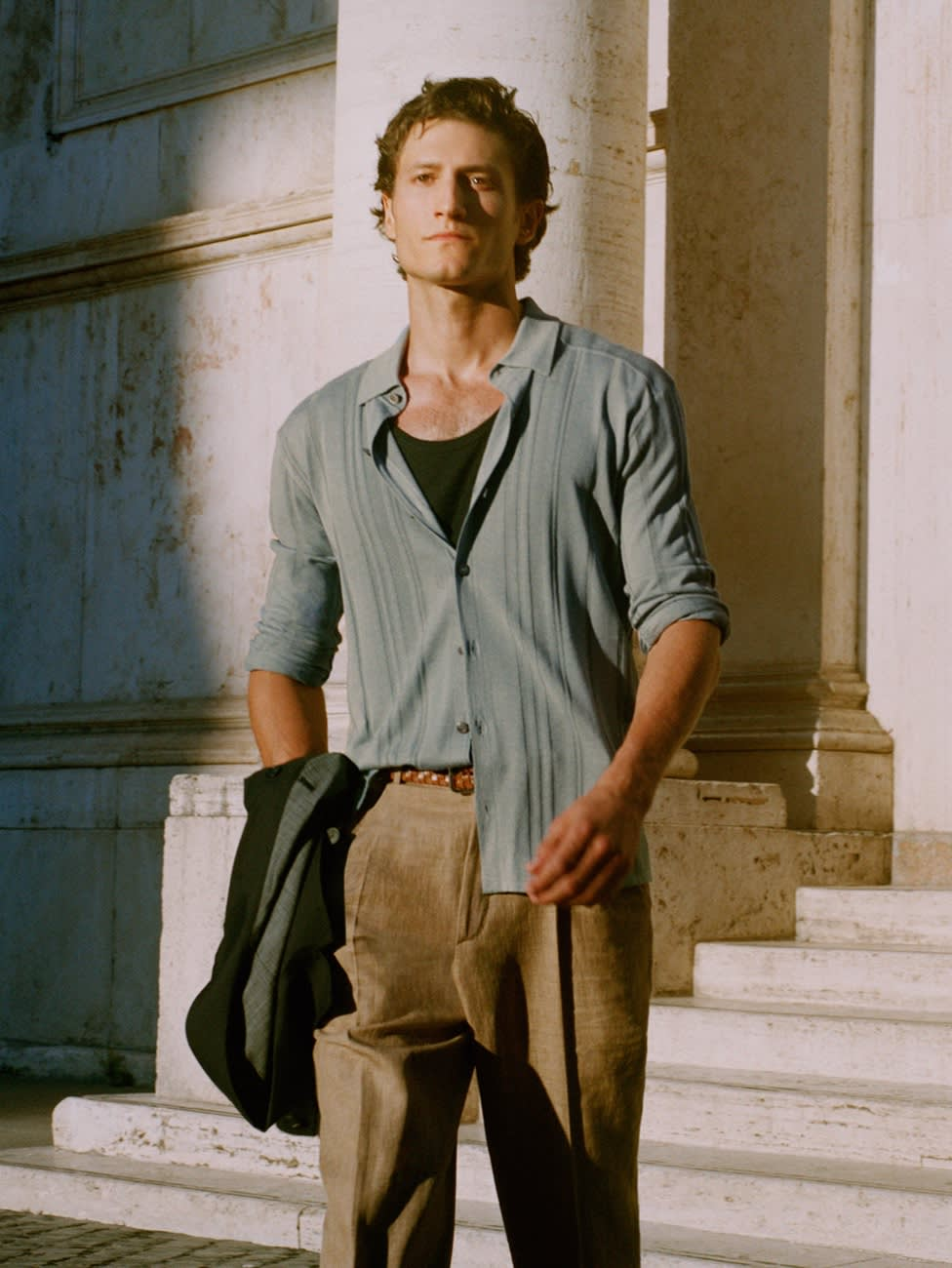 Male model wearing a knitted shirt and linen trousers