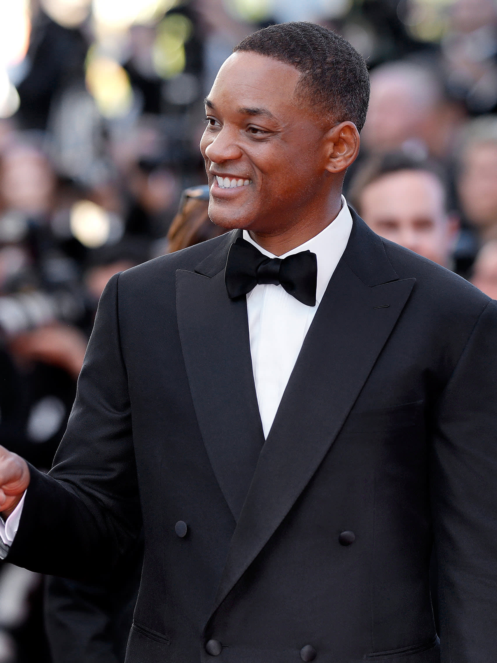 Will Smith wearing a Brioni bespoke black tuxedo