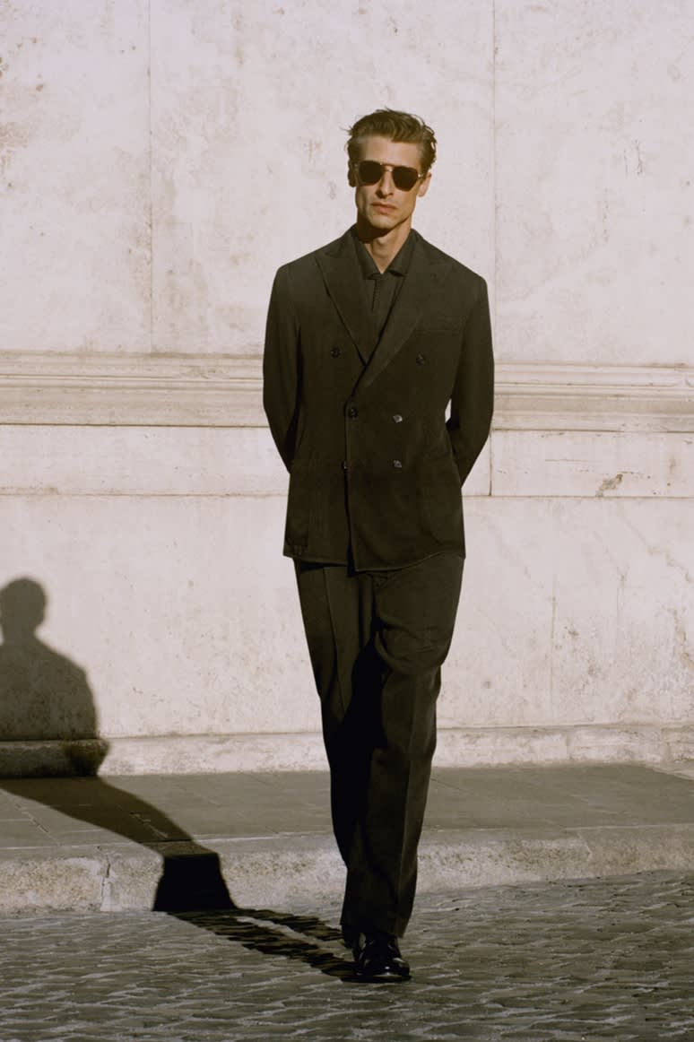 Male model wearing a dark green washed silk double-breasted jacket and trousers